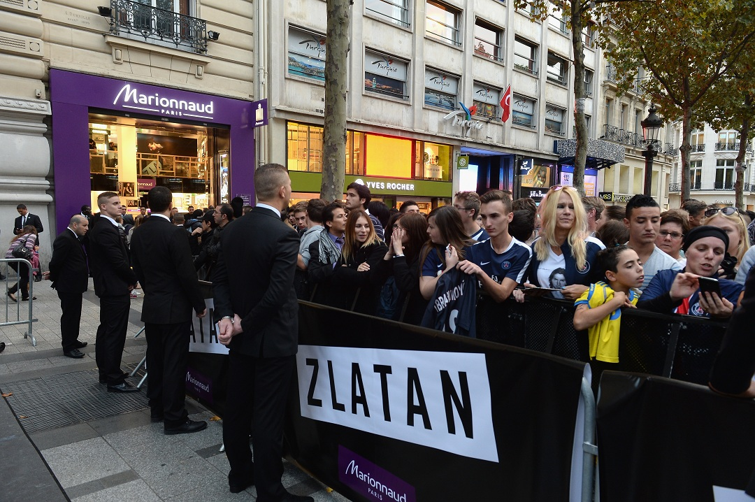 PARIS, FRANCE - OCTOBER 27: The crowd gathers on the Champs Elysees for the Launch of Zlatan Ibrahimovic Perfume at Marionnaud Champ-Elysees on October 27, 2015 in Paris, France. (Photo by Dominique Charriau/Getty Images for Marionnaud)