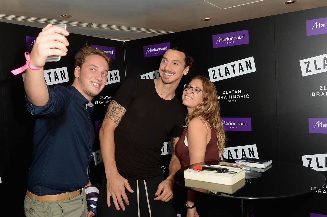 PARIS, FRANCE - OCTOBER 27: Zlatan Ibrahimovic poses with fans during the Launch of Zlatan Ibrahimovic Perfume at Marionnaud Champ-Elysees on October 27, 2015 in Paris, France. (Photo by Dominique Charriau/Getty Images for Marionnaud) *** Local Caption *** Zlatan Ibrahimovic